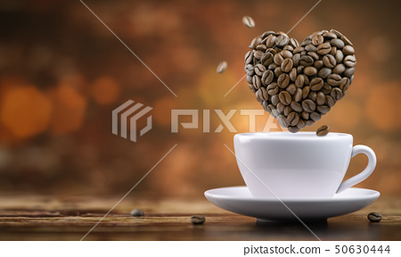 Coffee cup with a heart from coffee beans  50630444