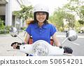 Delivering food on scooter 50654201
