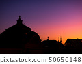 Profile of the roofs of the city at sunset 50656148