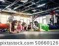 People exercising at gym 50660126