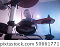 Drummer rehearsing on drums before rock concert. Man recording music on drum set in studio 50661771