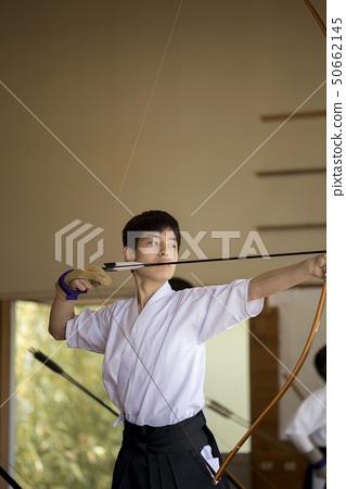 Junior high school boy doing archery 50662145