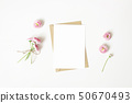 Feminine stationery, desktop mock-up scene. Vertical blank greeting card, craft paper envelope and 50670493