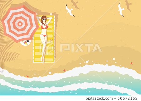 Woman on beach lounger top view 50672165
