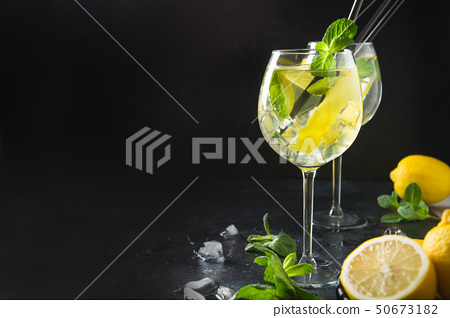 Mojito cocktail or lemonade with lime and mint.