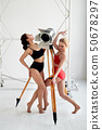 Two beautiful gymnasts stand and look into the distance.Sport, dance, healthy lifestyle. 50678297
