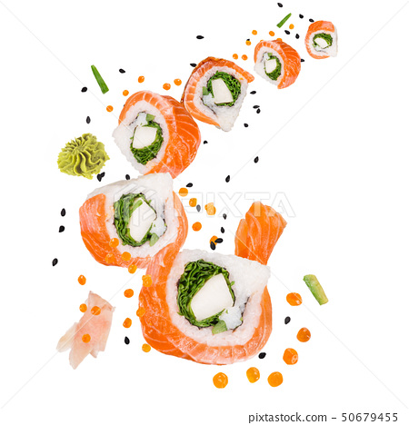 Pieces of delicious japanese sushi frozen in the air. 50679455