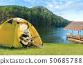 Happy traveler lifestyle women on vacation camping 50685788