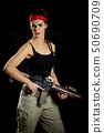 woman posing in a military outfit and a rifle 50690709