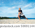 Senior man exercising on the beach 50691144