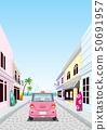 여름 거리를 드라이브하는 분홍색 자동차 후면 50691957