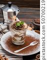 Classic tiramisu dessert in a glass on wooden background 50700219