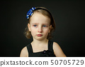 Emotional child with tears - a young girl crying, fine art portrait 50705729