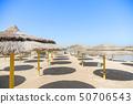 Umbrellas with sunbeds on beautiful sandy. 50706543