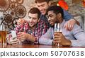 Men Having Fun. Friends Using Smartphone And Drinking Beer 50707638