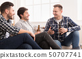 Happy Mates Drinking Beer And Talking At Home 50707741
