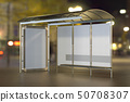 Bus Stop with advertising panels on the night city 50708307