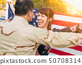 Excited Woman With American Flag Runs to Soldier 50708314