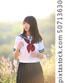 Portrait of asian japanese school girl costume looking at park outdoor in sunrise 50713630