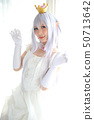 Portrait of vampire dracula young woman dress in white tone room halloween concept 50713642