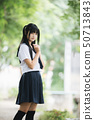 Portrait of asian japanese school girl costume looking at park outdoor film vintage style 50713843