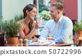 Young couple at restaurant 50722996