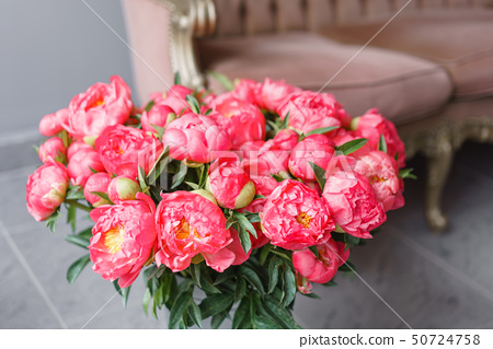 Coral peonies in a metal vase. Beautiful peony flower for catalog or online store. Floral shop 50724758