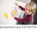 Boy having his breakfast at home 50726793