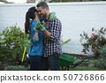 Couple dancing in the garden 50726866