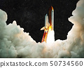 Spaceship takes off into space.  50734560