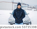 Handsome young man in winter jacket 50735398