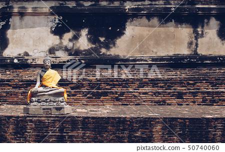 Ancient Buddha statues placed on brick walls. 50740060