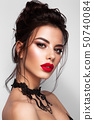 Gorgeous Young Brunette Woman face portrait. Red lips 50740084