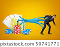 Young businessman stuck to playing cards and casino chips with blue sticky slime on yellow 50741771