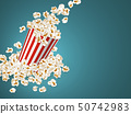 Full striped bucket with falling popcorn. 50742983
