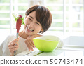 Woman housewife cooking salad 50743474