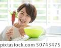 Woman housewife cooking salad 50743475