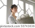 Woman housework laundry 50743636
