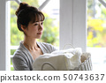 Woman housework laundry 50743637
