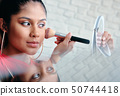 Mirror Close-Up Of Young Woman Applying Make-Up For Beauty 50744418