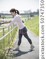 Stretching woman outdoor sports preparation 50747350