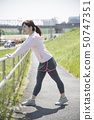 Stretching woman outdoor sports preparation 50747351
