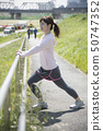 Stretching woman outdoor sports preparation 50747352