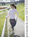 Stretching woman outdoor sports preparation 50747355