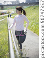 Stretching woman outdoor sports preparation 50747357