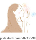Long-haired woman enjoying the scent 50749598