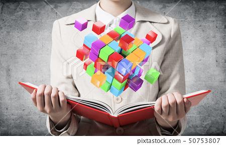 Woman showing colorful geometric 3d cubes 50753807