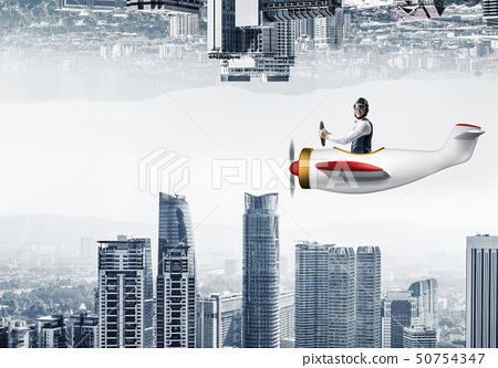 Businessman flying in small airplane 50754347