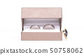 Wedding rings in box, small man climbing into the 50758062