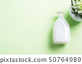 White natural soap bottle on pastel green 50764989